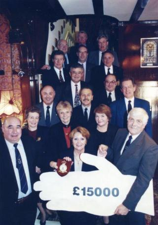 This was the presentation of the £15,000 cheque to Richard Peck House at St Annes on 10th February 1997.   People present, From the back left to right, .....? Ken Hillman,Trevor Caine,Mike Moore, Mike Halpin,Fred Knox,Chas Challis,Al Silsby,Colin Fosberry, Frank Deegan, Eric Cutbush, Mrs Hillman,........? Mrs Symonds,Matt Macintyre,Ann Mulvey,and Peter Symonds